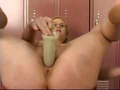 charming juvenile blond in glasses strips, plays