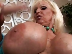 tanned blond with giant meatballs engulfing