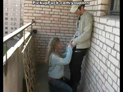 youthful blonde sucking on the veranda