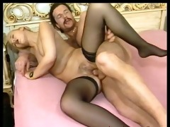 youthful couple copulates on the bed.