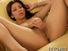 cutie plays with 2 dildos
