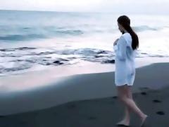 darkhair juvenile sweetheart teasing on the beach