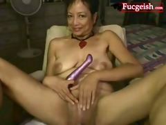 old lady masturbating using marital-device