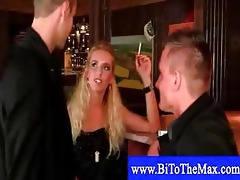 couple screwing around at a bar with young stud