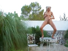 juvenile blonde woman dancing and makes water
